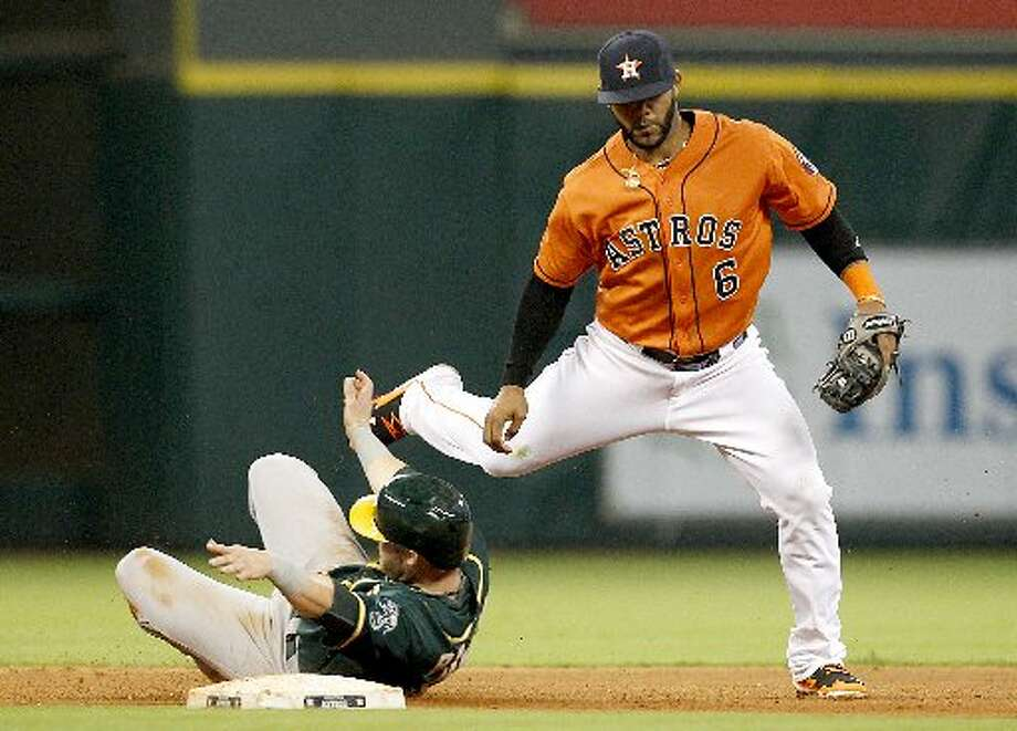Athletics first baseman Daric Barton (10) is tagged out while sliding under Houston Astros shortstop Jonathan Villar (6) in the fourth inning. Photo: Thomas B. Shea, For The Chronicle