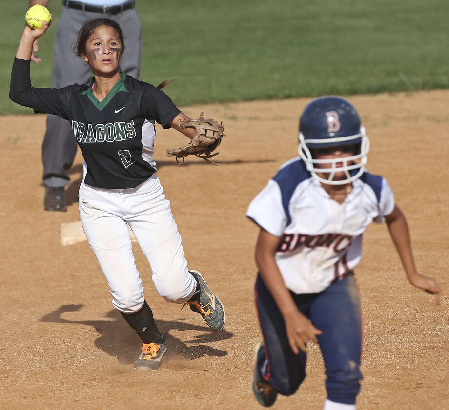 Southwest shortstop Kristal Salinas, throwing to third to try and get a Brandeis runner out, belted a two-run homer to help the Dragons earn a 1-0 series lead. Photo: Tom Reel / San Antonio Express-News