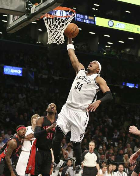 Nets forward Paul Pierce, who had 18 points and five rebounds, goes in for a dunk in Game 3 against the Raptors. Pierce's playoff experience helped Brooklyn withstand Toronto's rally. Photo: Michelle V. Agins / New York Times / NYTNS