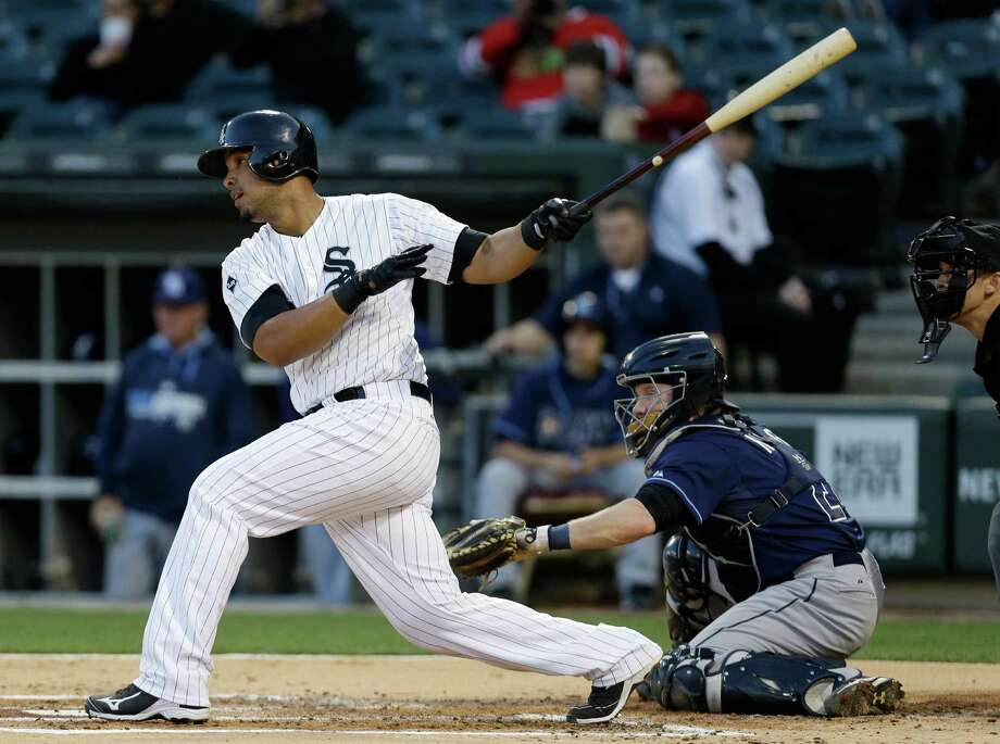 Chicago White Sox's Jose Abreu hits an one-run single during the first inning of a baseball game against the Tampa Bay Rays in Chicago on Friday, April 25, 2014. (AP Photo/Nam Y. Huh) Photo: Nam Y. Huh, STF / AP