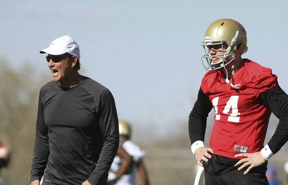 """Baylor coach Art Briles (left), with starting quarterback Bryce Petty, shrugs off the recent trash talk. """"Shoot, everybody is entitled to their opinion,"""" he said. Photo: Rod Aydelotte / Waco Tribune-Herald / Waco Tribune Herald"""