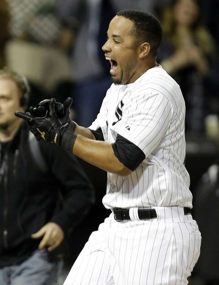 Chicago White Sox first baseman Jose Abreu celebrates as he rounds the bases after his game-winning grand slam. Photo: Nam Y. Huh, Associated Press