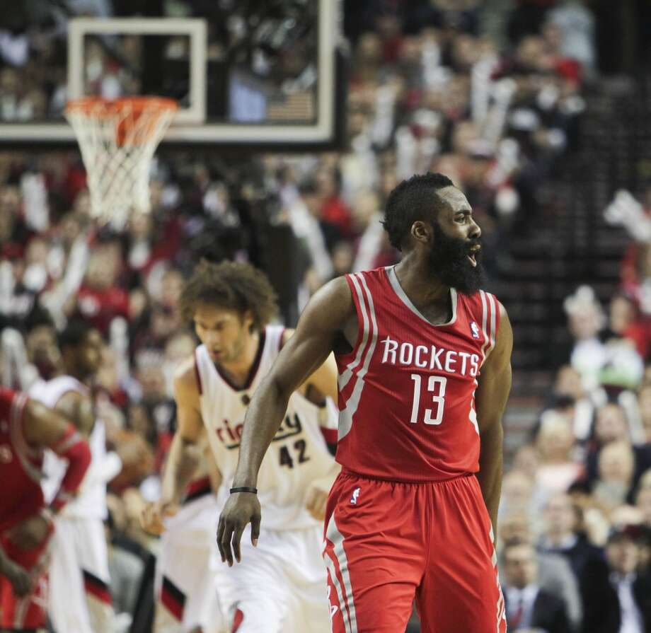 Rockets guard James Harden reacts after a basket. Photo: James Nielsen, Houston Chronicle