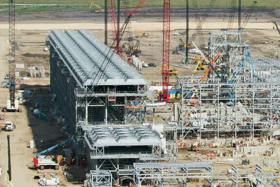 Construction continues on Cheniere Energy Partners  Sabine Pass natural gas liquefaction and export terminal in Cameron Parish. The project is an expansion of Cheniere s existing import terminal on the site. (Cheniere Energy Partners photo received December 2013.)