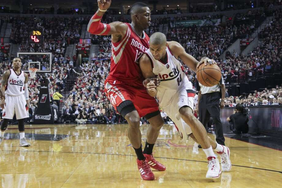 Rockets center Dwight Howard defends against Trail Blazers forward Nicolas Batum. Photo: James Nielsen, Houston Chronicle