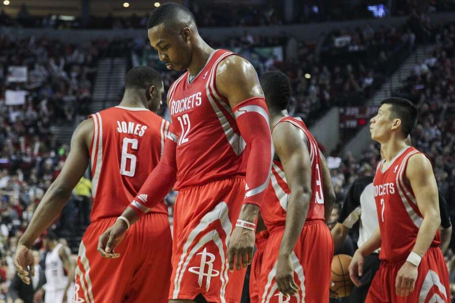 Rockets center Dwight Howard walks back onto the court following a timeout during the second half. Photo: James Nielsen, Houston Chronicle