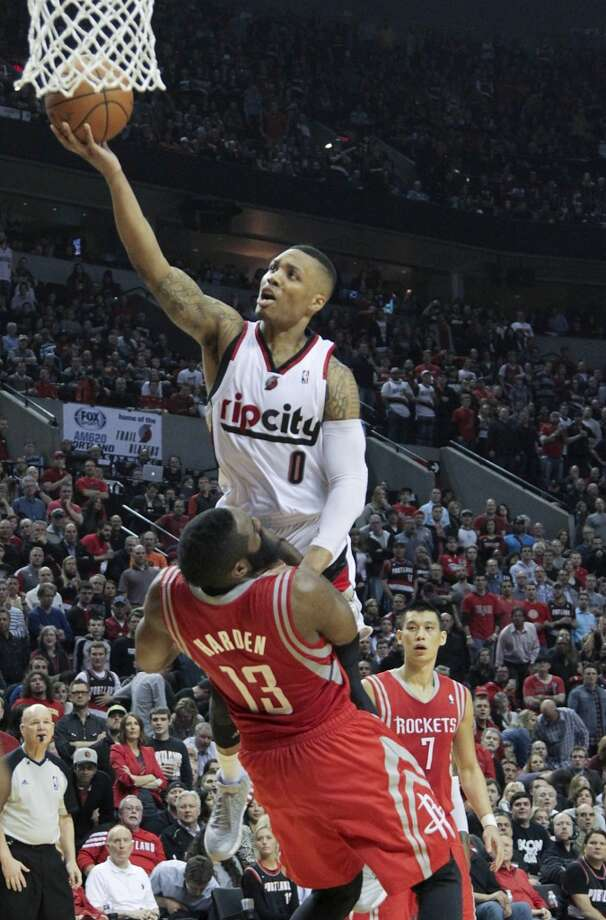 Portland Trail Blazers guard Damian Lillard shoots over Houston Rockets guard James Harden during the second half. Photo: James Nielsen, Houston Chronicle