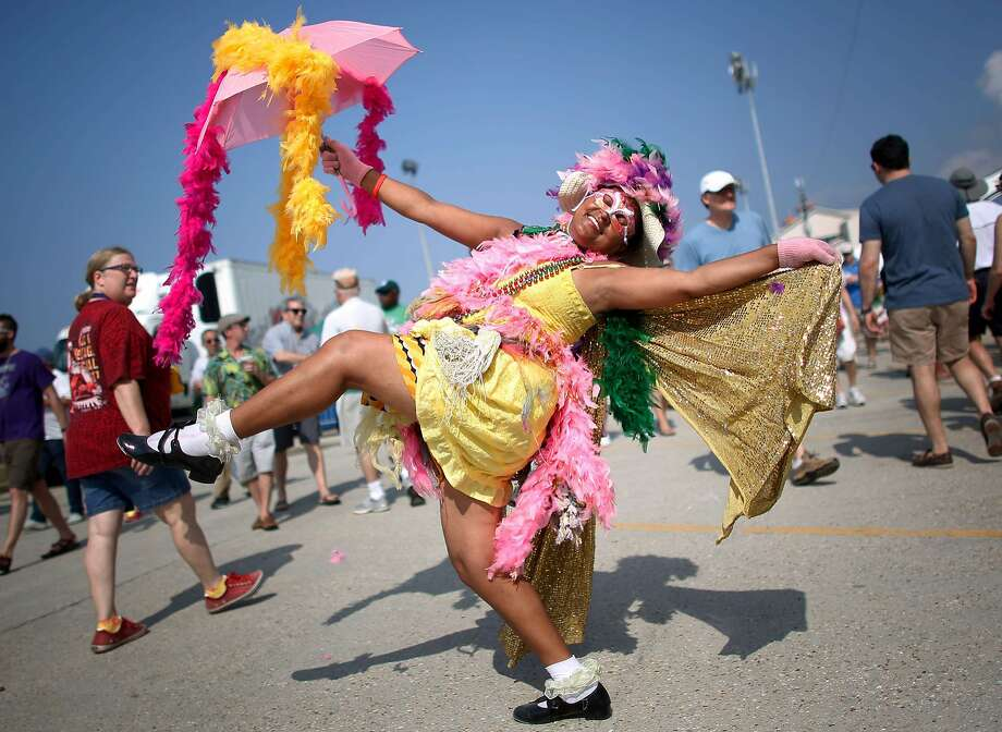 Jennifer Jones of New Orleans parades during the first day of the New Orleans Jazz and Heritage Festival in New Orleans, Louisiana April 25, 2014. REUTERS/Jonathan Bachman (UNITED STATES - Tags: ENTERTAINMENT SOCIETY) Photo: Jonathan Bachman, Reuters