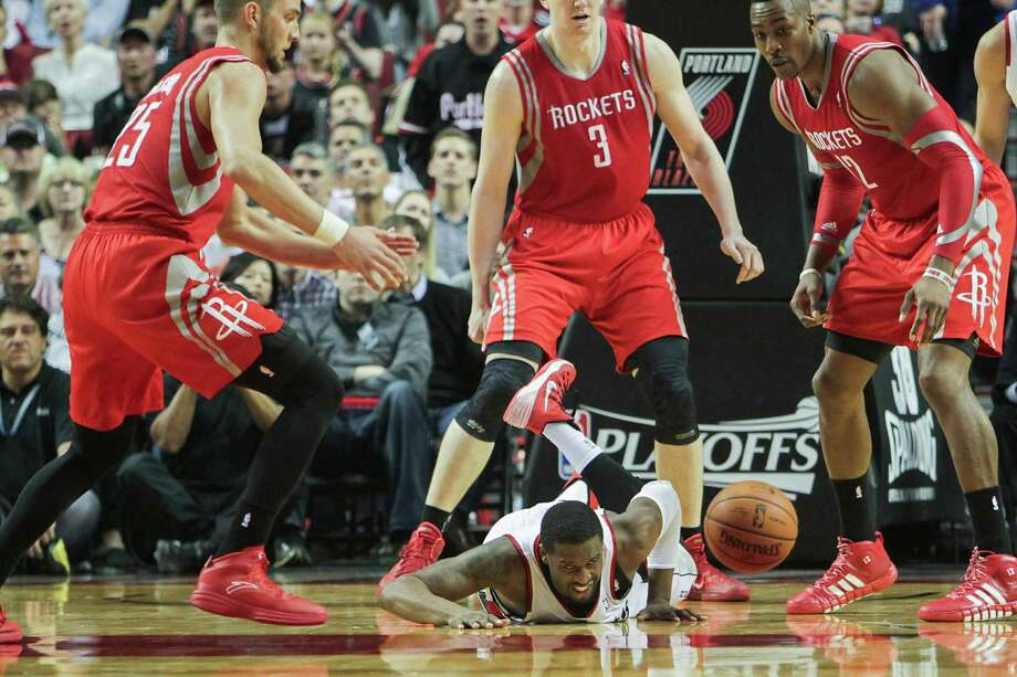 Trail Blazers guard Wesley Matthews hits the floor in pursuit of a loose ball Friday night. Rockets forward Chandler Parsons admits the Blazers have done a better job of hustling on those kind of plays. Photo: James Nielsen, Staff / © 2014  Houston Chronicle