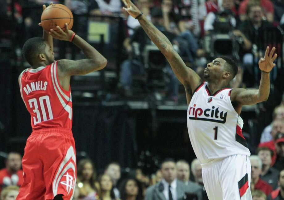 A D-Leaguer during the regular season, rookie Troy Daniels came up clutch in Friday's win for the Rockets, much to the dismay of Portland's Dorell Wright. Photo: James Nielsen, Staff / © 2014  Houston Chronicle