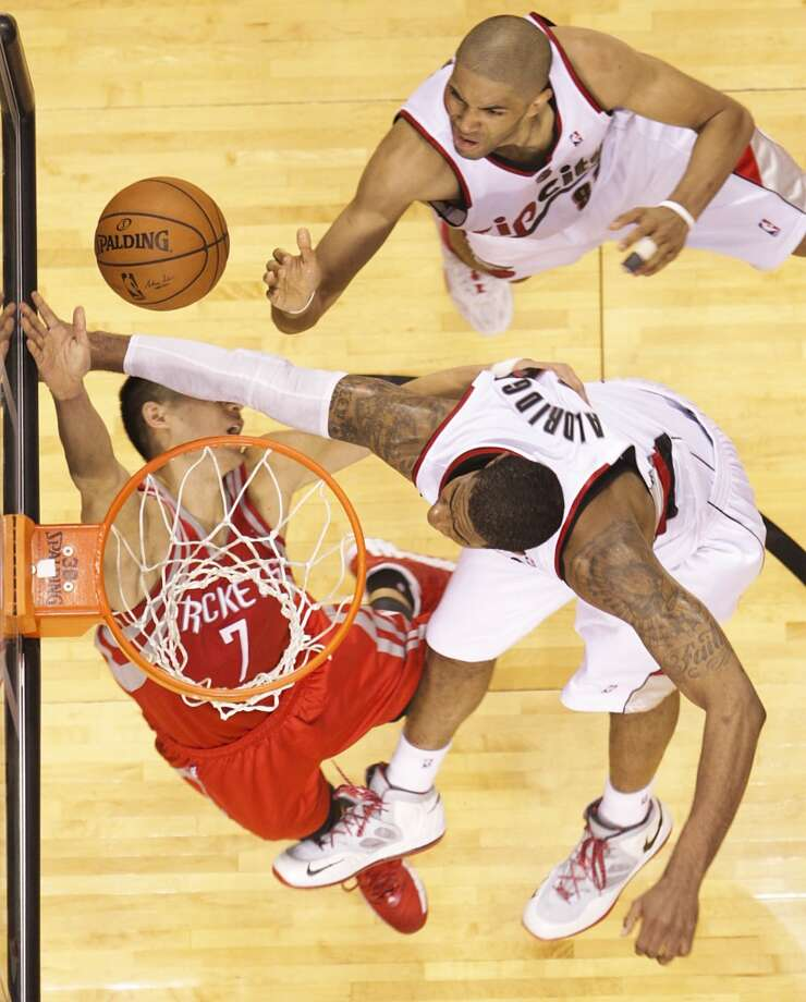 Rockets guard Jeremy Lin is hit by Portland forward LaMarcus Aldridge during the second half. Photo: James Nielsen, Houston Chronicle