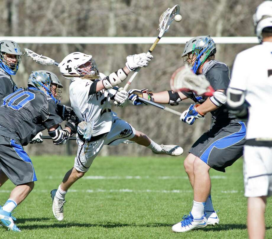 Joel Barlow High School's Liam Murphy fires a shot during a game against Newtown High School, played at Joel Barlow. Thursday, April 24, 2014 Photo: Scott Mullin / The News-Times Freelance