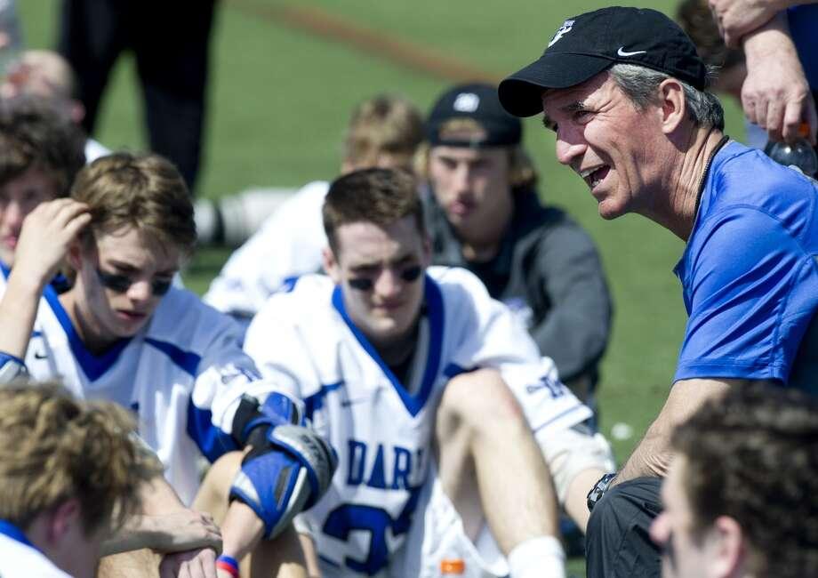Darien coach Jeff Brameier talks to his team during Saturday's boys lacrosse game against Manhassett in Darien, Conn., on April 19, 2014. Photo: Lindsay Perry