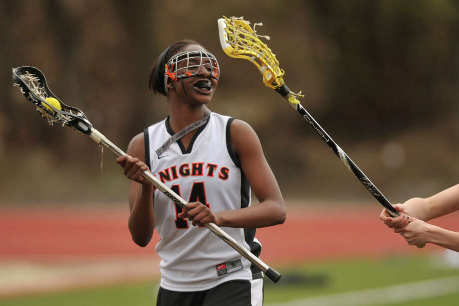 Stamford's Caamry Evans looks for an open team mate down field during the Black Knights' game against Fairfield Warde at Stamford High School in Stamford, Conn., on Tuesday, April 22, 2014. Fairfield Warde won, 12-6. Photo: Jason Rearick / Stamford Advocate