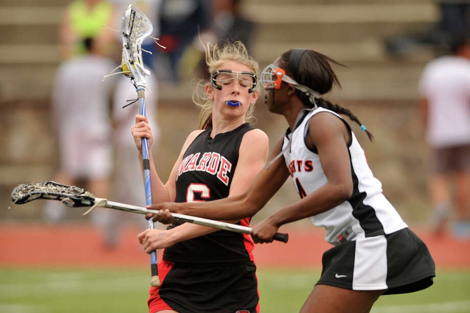 Fairfield Warde's Hannah Dougherty meets resistance from Stamford's Camry Evans during their game at Stamford High School in Stamford, Conn., on Tuesday, April 22, 2014. Fairfield Warde won, 12-6. Photo: Jason Rearick / Stamford Advocate