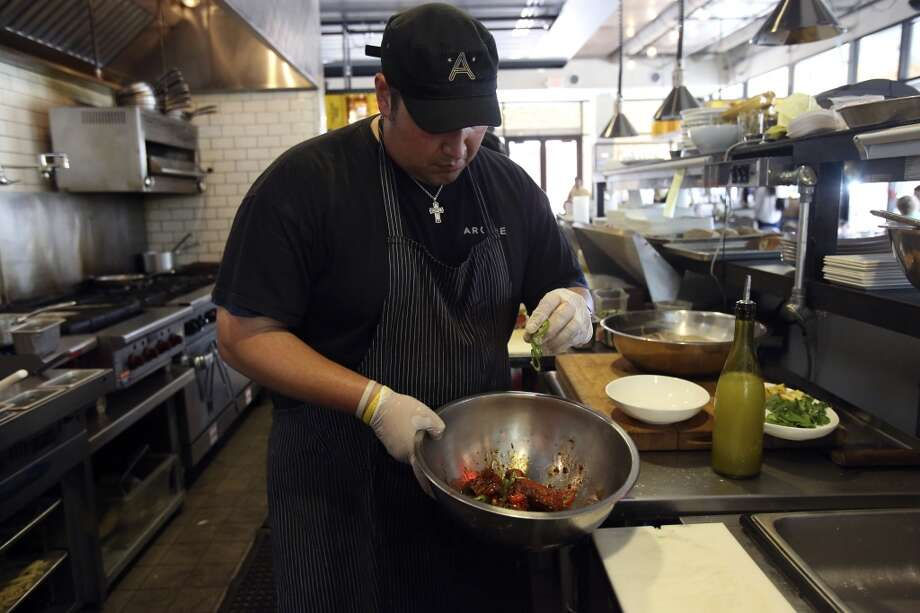 Jesse Perez of Arcade Midtown Kitchen prepares his version of chicken wings on Wednesday June 13, 2013. Photo: Helen L. Montoya, San Antonio Express-News