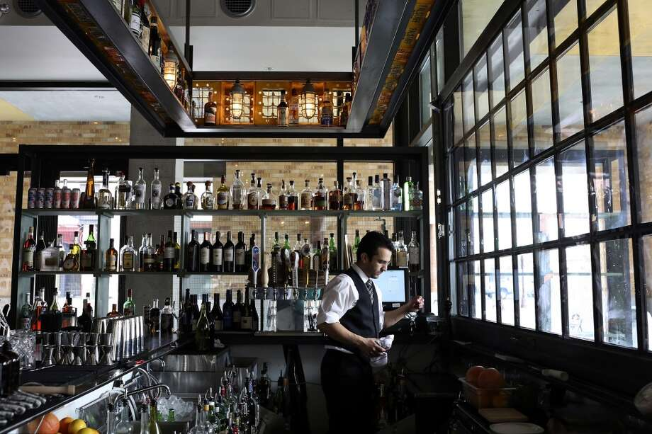Bartender Joshua Bryand prepares the bar for the evening at Arcade Midtown Kitchen at The Pearl in San Antonio on Tuesday, May 21, 2013. Photo: Lisa Krantz, San Antonio Express-News