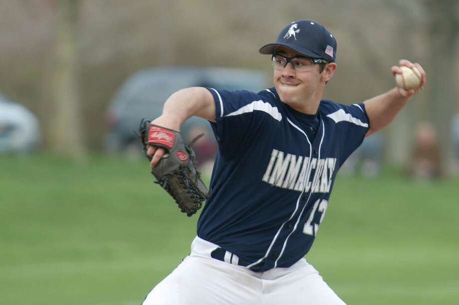 Mike Fredette, #13, was one of the multiple pitchers Immaculate used during the SWC boys baseball game between Newtown High School and Immaculate High School, in Danbury, Conn, on Friday, April 25, 2014. Photo: H John Voorhees III / The News-Times Freelance