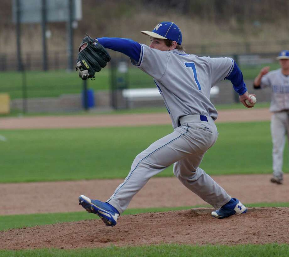 Newtown pitcher Connor Miller, #7, during the SWC boys baseball game between Newtown High School and Immaculate High School, in Danbury, Conn, on Friday, April 25, 2014. Photo: H John Voorhees III / The News-Times Freelance