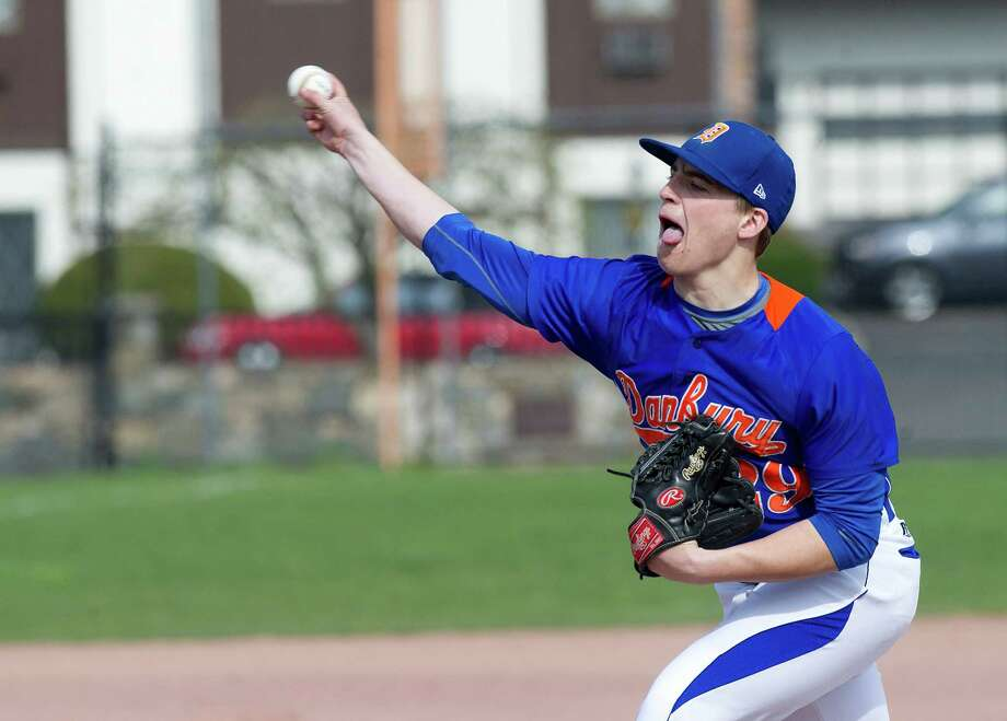 Danbury's Dan Clancy sticks out his tongue as he pitches during Friday's baseball game at Stamford High School on April 25, 2014. Photo: Lindsay Perry / Stamford Advocate