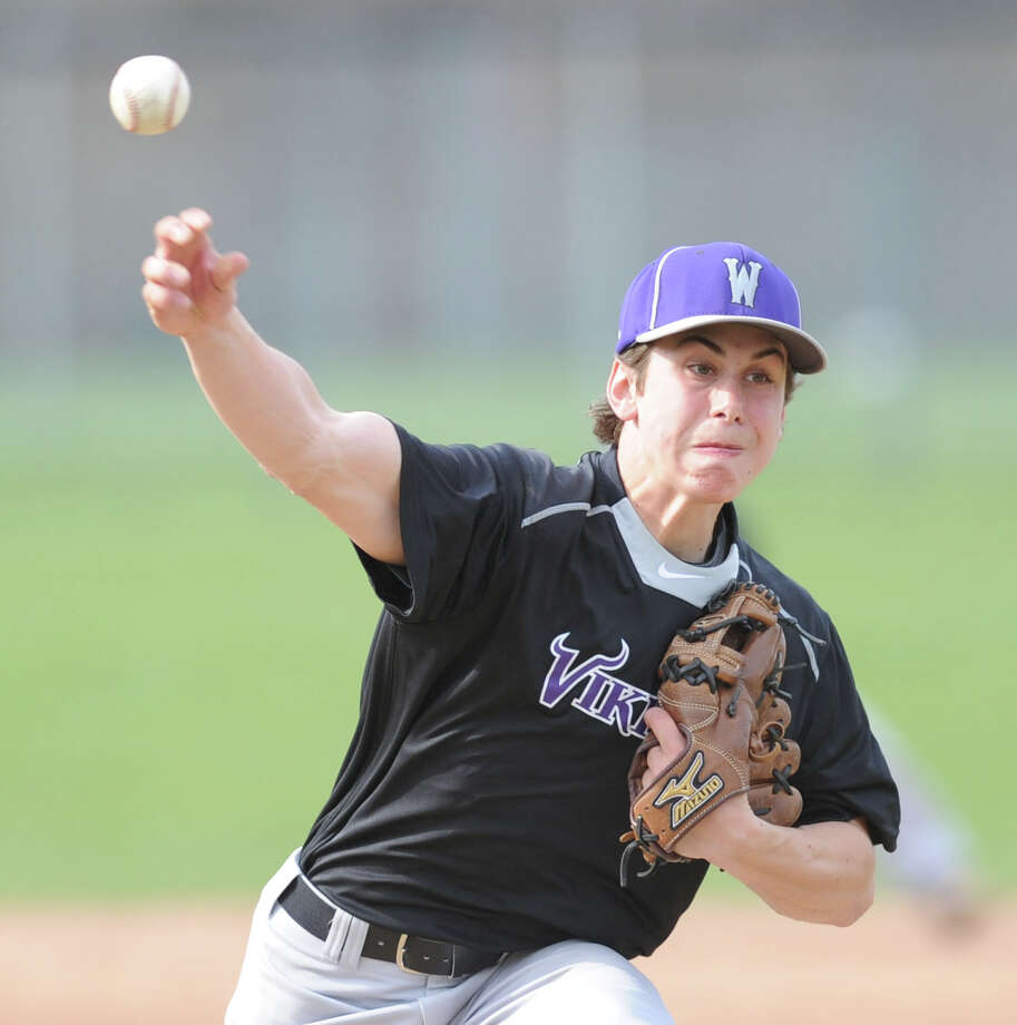 Westhill pitcher Cam Elkins throws during the high school baseball game between Greenwich High School and Westhill High School at Greenwich, Friday afternoon, April 25, 2014. Photo: Bob Luckey / Greenwich Time