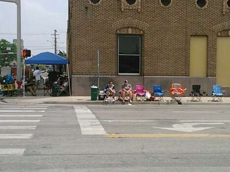 People already in their spots waiting for the start of the Fiesta Flambeau parade on Saturday, April 26, 2014. Some have been here since 7 a.m. Photo: Mark D. Wilson, San Antonio Express-News