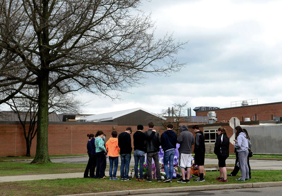 For a second day, students gather around the memorial made for stabbing victim Maren Sanchez, in front of Jonathan Law High School in Milford, Conn. on Saturday April 26, 2014. Sanchez was stabbed to death on Friday morning, which was to be the day of the school's junior prom. Photo: Christian Abraham / Connecticut Post