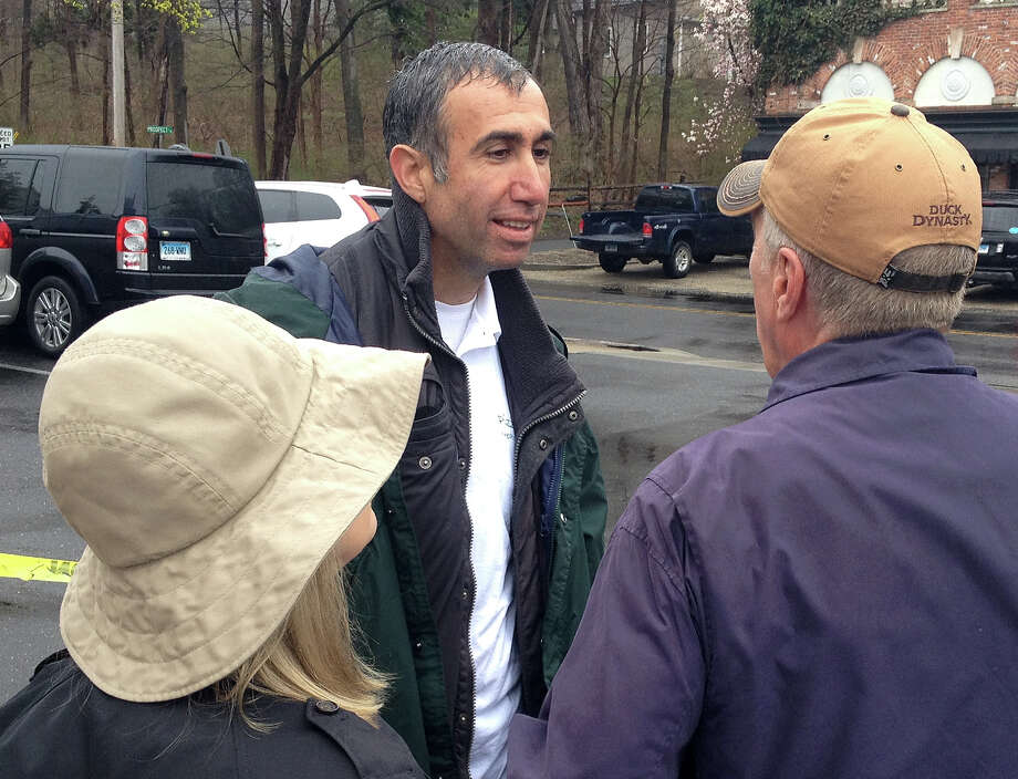 Sammy Palik, owner of Sammyís Southport Pizza & Grill that was damaged by fire nearly two weeks ago, talks with two supporters who turned out for a community rally to raise money for the Southport Center business. Photo: Thomas Lawlor / Fairfield Citizen