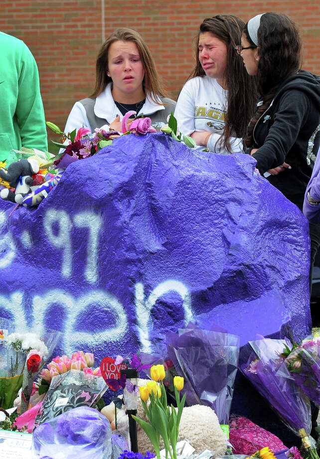 For a second day, students gather around the memorial made for stabbing victim Maren Sanchez, in front of Jonathan Law High School in Milford, Conn. on Saturday April 26, 2014. Sanchez was stabbed to death on Friday morning, which was to be the day of the school's junior prom.Today, students and anyone from the community were able to gather in the school's gym for food provided by local businesses. Photo: Christian Abraham / Connecticut Post