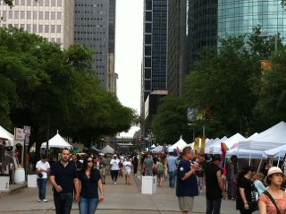 The city's 44th annual iFest celebrates Australia, but showcases many different countries.  The streets bordering City Hall were filled with markets selling jewelry, hand-crafted clothing and purses, toys and decorations inspired by vendors' homelands. Photo: Rebecca Heliot / Houston Chronicle