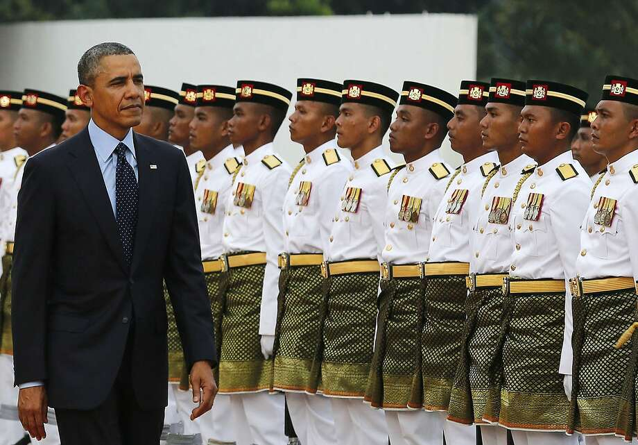 President Obama inspects an honor guard as he arrives in Kuala Lumpur, the latest stop on his visit to U.S. allies in Asia. Obama has kept an eye on developments in Russia and Ukraine. Photo: Larry Downing, Reuters