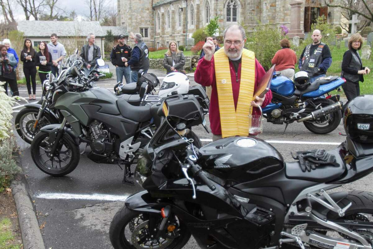 """The """"Blessing of the Bikes"""" at St. Pauls on the Green in Norwalk, Conn. The 275-year-old Episcopal church hosted Bikers from around the area as their motorcycles were blessed by Rev. Nicholas Lang, the rector of St. Pauls. Donations at the event benefited the Person-To-Person food pantry in Norwalk."""