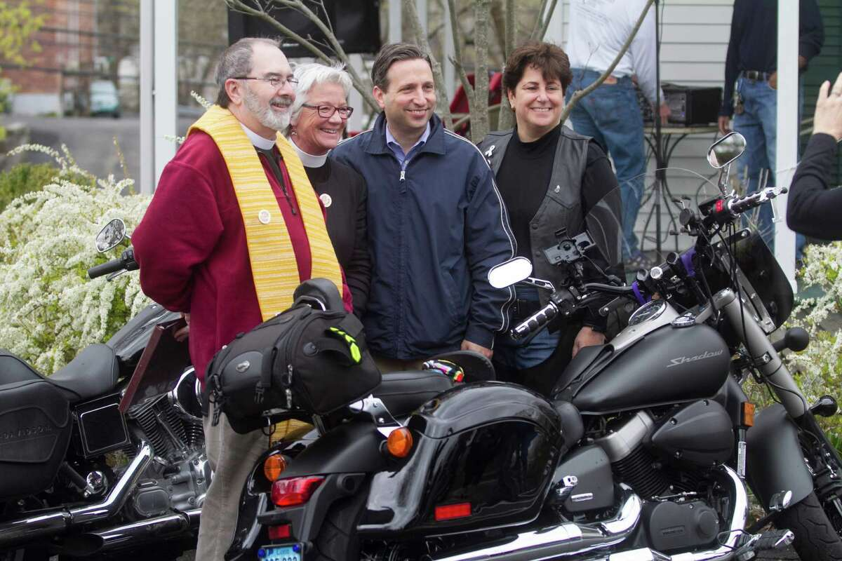 Rev. Nicholas Lang, Rev. Cindy Stravers, State Senator Bob Duff and Jeannette Boccuzzi pose for a photo during the