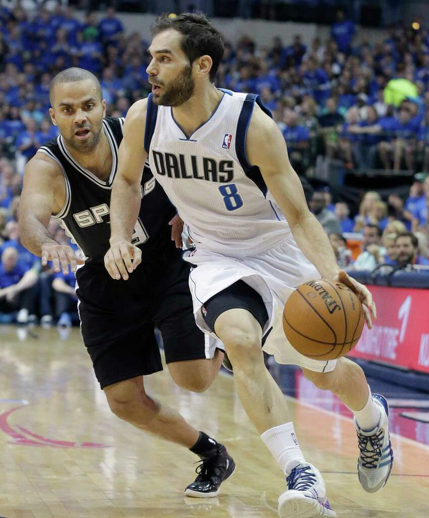 Dallas Mavericks guard Jose Calderon (8) of Spain, drives against San Antonio Spurs guard Tony Parker (9) of France, during the first half in Game 3 in the first round of the NBA basketball playoffs in Dallas, Saturday, April 26, 2014. (AP Photo/LM Otero)