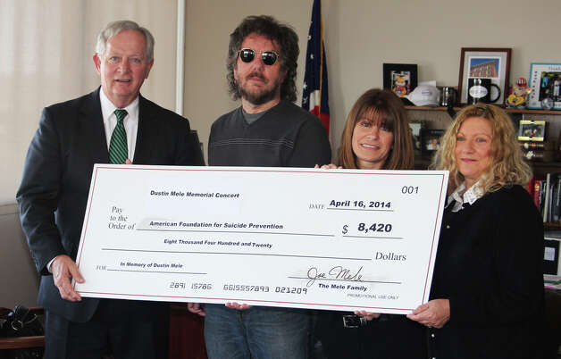 On April 16 the parents of Dustin Mele, who died at age 28 in March 2013, presented a check to the American Foundation for Suicide Prevention?s Capital Region Area Director Laura Marks at Troy City Hall. The check represents donations raised at the Dustin Mele Memorial Concert event on March 30. Shown are Deputy Mayor Peter Ryan, Joe Mele, Marks and Patti Quade, Dustin's mother. (Submitted photo)