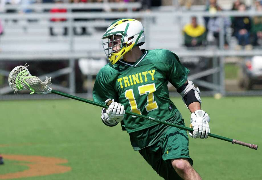 Trinity Catholic's Justin Prypek controls the ball during Saturday's boys lacrosse game at Stamford High School on April 26, 2014. Photo: Lindsay Perry / Stamford Advocate