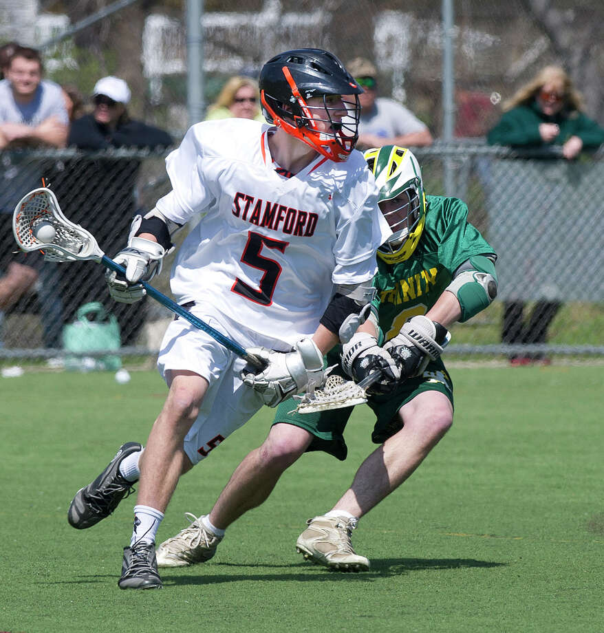 Stamford's Kaden Bouldin controls the ball during Saturday's boys lacrosse game at Stamford High School on April 26, 2014. Photo: Lindsay Perry / Stamford Advocate