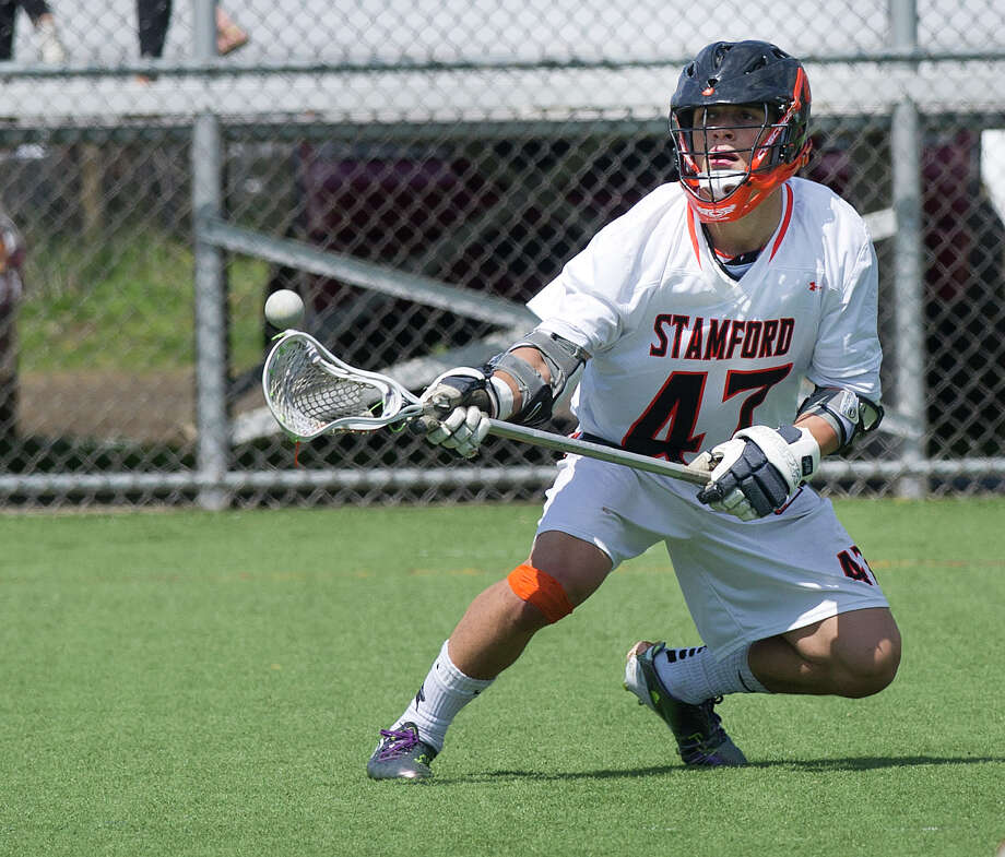 Stamford's Andrew Kydes catches a pass during Saturday's boys lacrosse game at Stamford High School on April 26, 2014. Photo: Lindsay Perry / Stamford Advocate