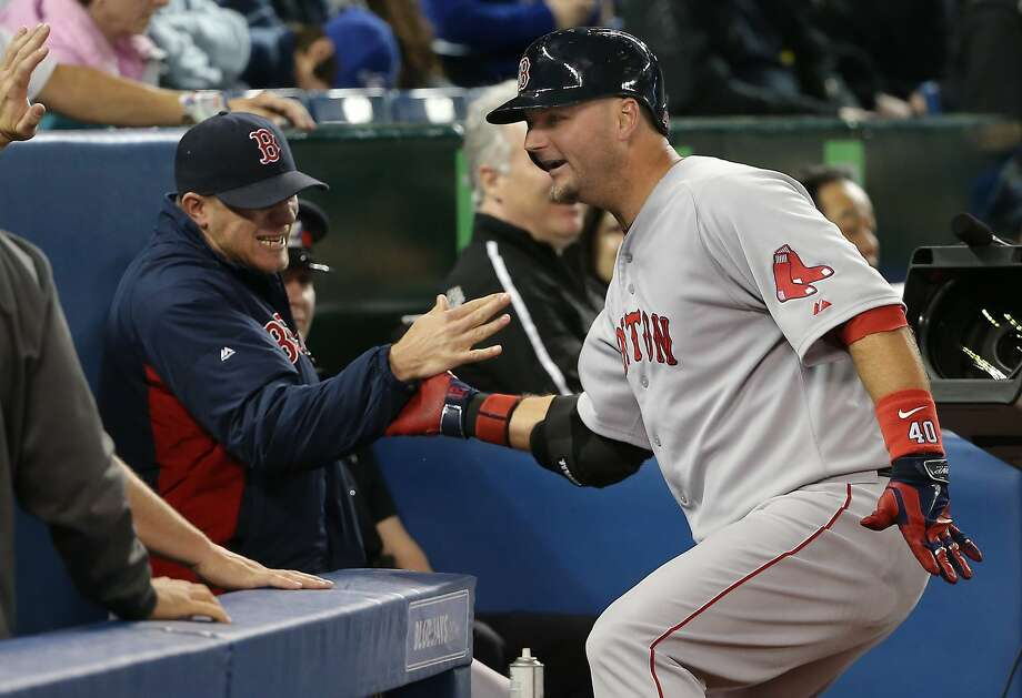 Boston's A.J. Pierzynski had reason to smile after belting a third-inning grand slam in Toronto. Photo: Tom Szczerbowski, Getty Images