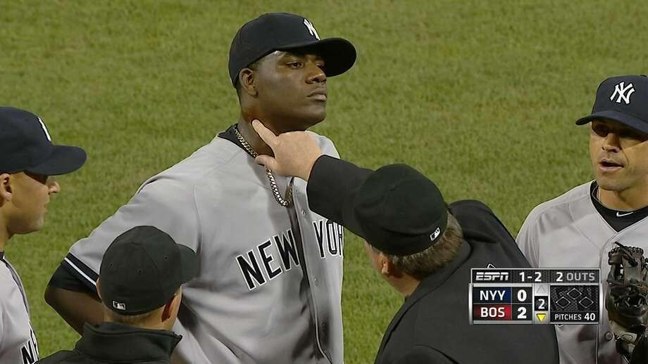 Umpire Gerry Davis finds pine tar on the neck of Yankees pitcher Michael Pineda on Wednesday. Photo: Associated Press