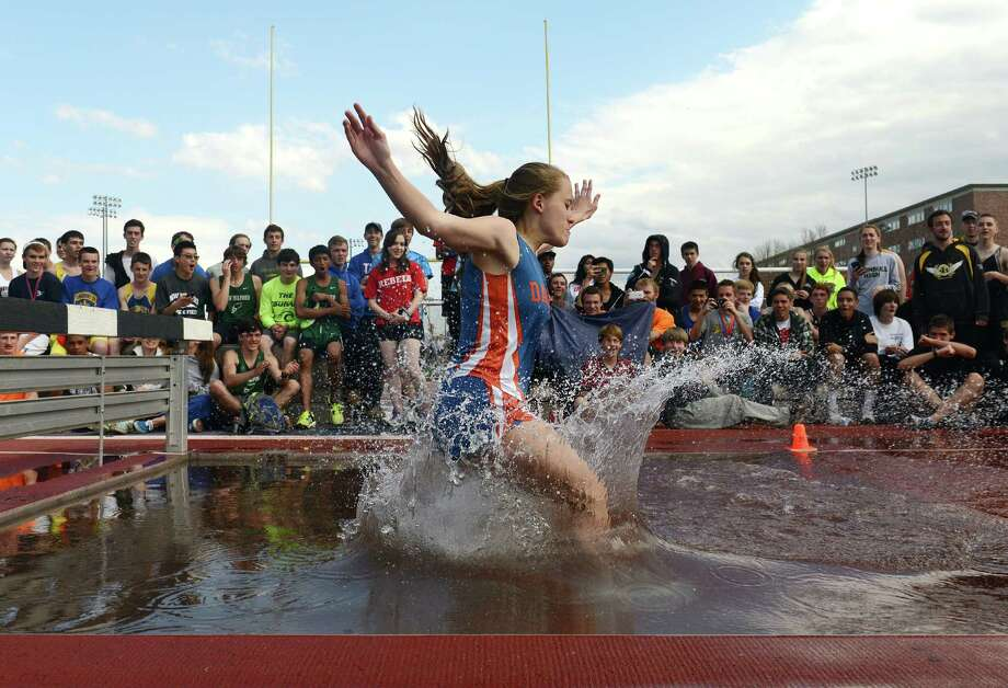 Danbury's Kaleigh Constantine competes in the 2000 meter steeplechase relay at the 34th annual O'Grady Relays track and field event at Danbury High School in Danbury, Conn. Saturday, April 26, 2014.  Constantine finished 13th overall and Darien's Anne Johnston won the event. Photo: Tyler Sizemore / The News-Times