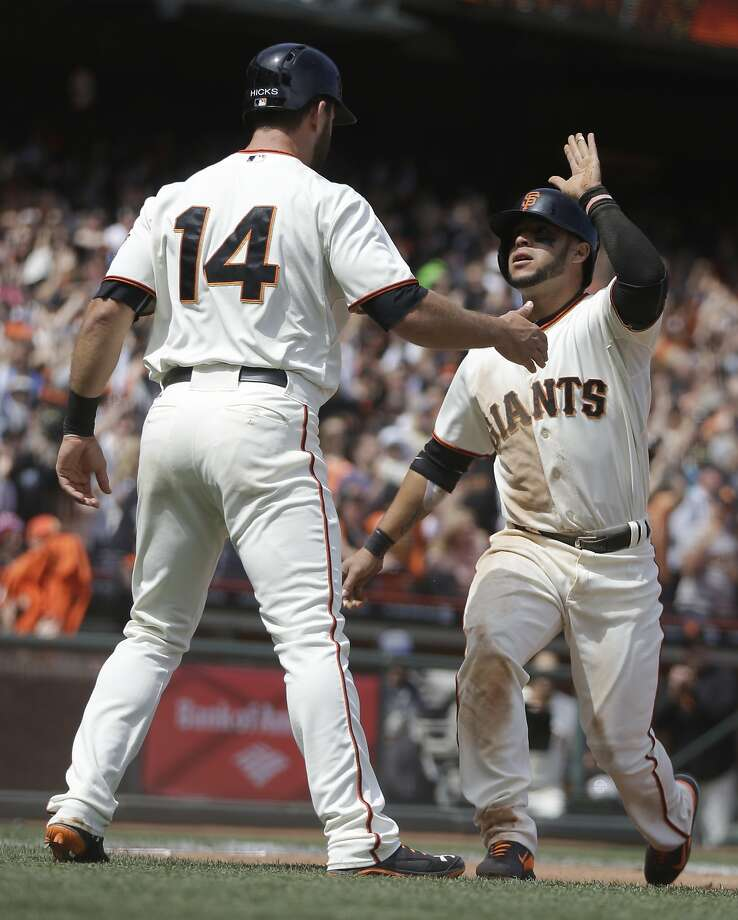 Brandon Hicks (14) and Gregor Blanco celebrate after scoring on Hunter Pence's single. Their runs capped a four-run fifth. Photo: Ben Margot, Associated Press