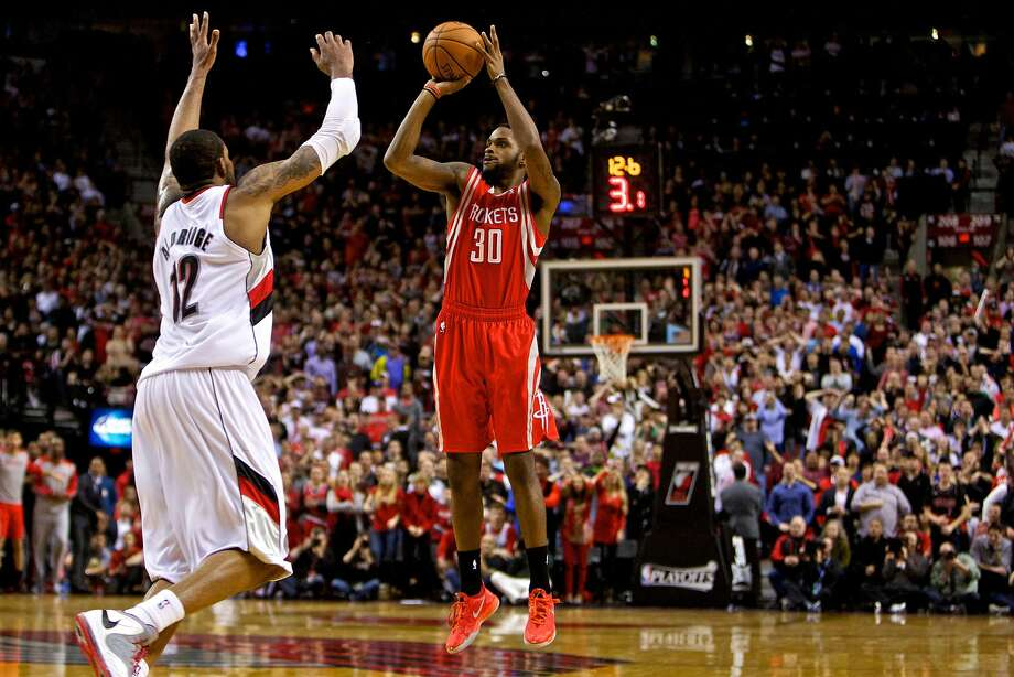 Troy Daniels, a sharpshooter who spent most of the season in the D-League, fires the go-ahead three-pointer for Houston in overtime, after taking a pass from a penetrating Jeremy Lin. Photo: Craig Mitchelldyer, Reuters