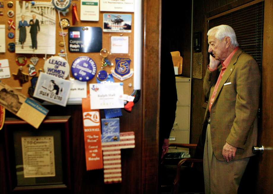GOP Rep. Ralph Hall takes a call during primary election night in Rockwall. He's seeking his 18th term in Congress but faces John Ratcliffe in a runoff. Photo: Amy Gutierrez/Special Contributo, Special Contributor / 10001897A