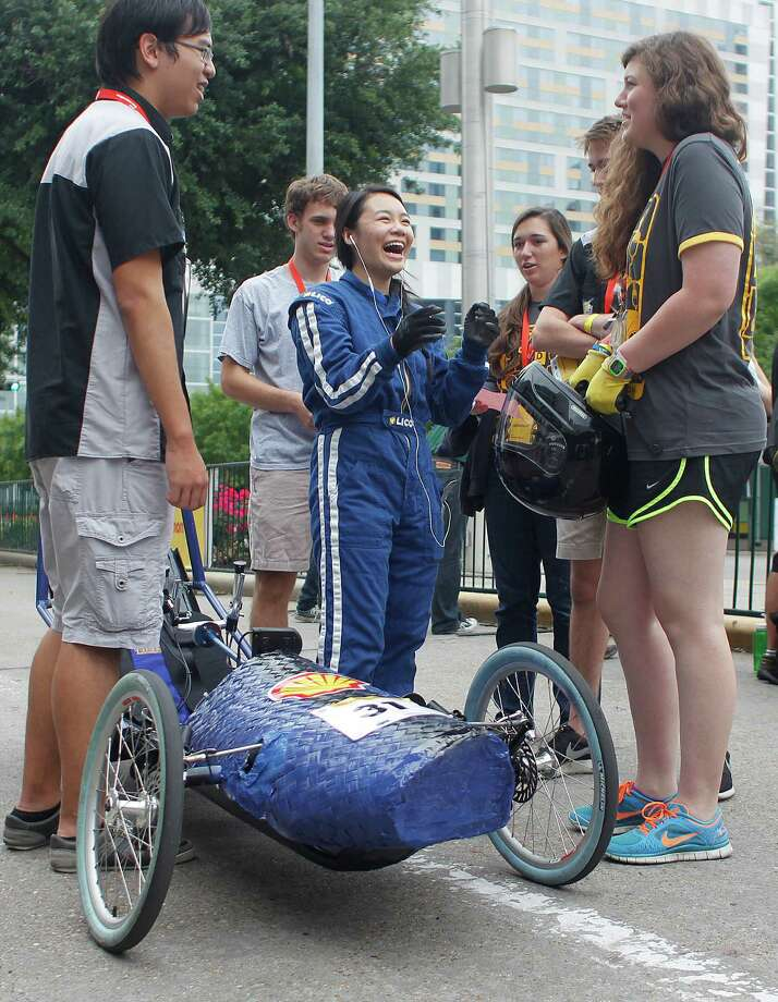 Westside High School senior, Sarah Wong, 17, center laughs with her team before driving her team's battery electric vehicle outside the George R. Brown Convention Center during the Shell Eco-marathon Saturday, April 26, 2014, in Houston. Photo: Johnny Hanson, Houston Chronicle / © 2014  Houston Chronicle