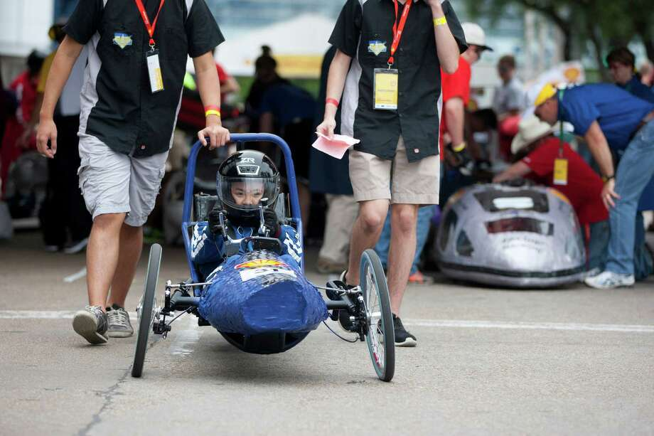 Westside High School senior, Sarah Wong, 17, is pushed into position before driving her team's battery electric vehicle. Photo: Johnny Hanson, Houston Chronicle / © 2014  Houston Chronicle