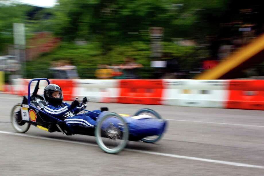 Sarah Wong, 17, a Westside High School senior, drives her team's battery electric vehicle around Discovery Green. Photo: Johnny Hanson, Houston Chronicle / © 2014  Houston Chronicle