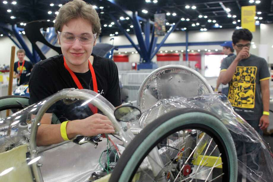 "Richard Appel, 16, a sophomore at St. John's School in Houston works on his team's vehicle during the Shell Eco-marathon at the George R. Brown Convention Center Saturday, April 26, 2014, in Houston. ""It's a great opportunity to work on something like this and be a part of a team,"" Appel said. Photo: Johnny Hanson, Houston Chronicle / © 2014  Houston Chronicle"