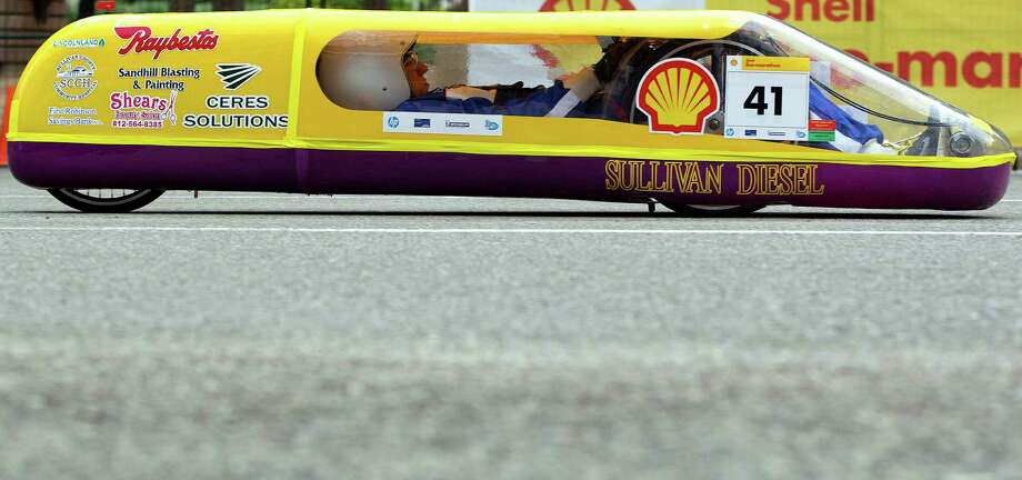 A student from Sullivan High School in Sullivan, Ind., drives the school's prototype vehicle during the Shell Eco-marathon at the George R. Brown Convention Center. Photo: Johnny Hanson, Houston Chronicle / © 2014  Houston Chronicle