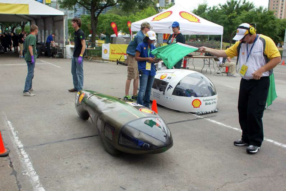 Two vehicles are waved on to start and make their way around the Discovery Green track during the Shell Eco-marathon at the George R. Brown Convention Center. Photo: Johnny Hanson, Houston Chronicle / © 2014  Houston Chronicle